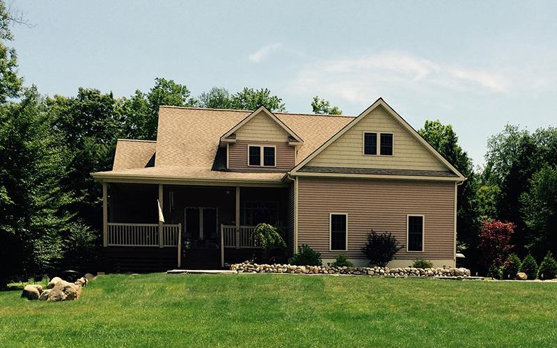 2 Story Light Brown House with Front Porch